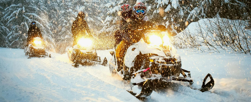 Explore the Heart of Quebec on a Snowmobile Trip!
