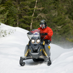 Surprise yourself: try snowmobiling Package